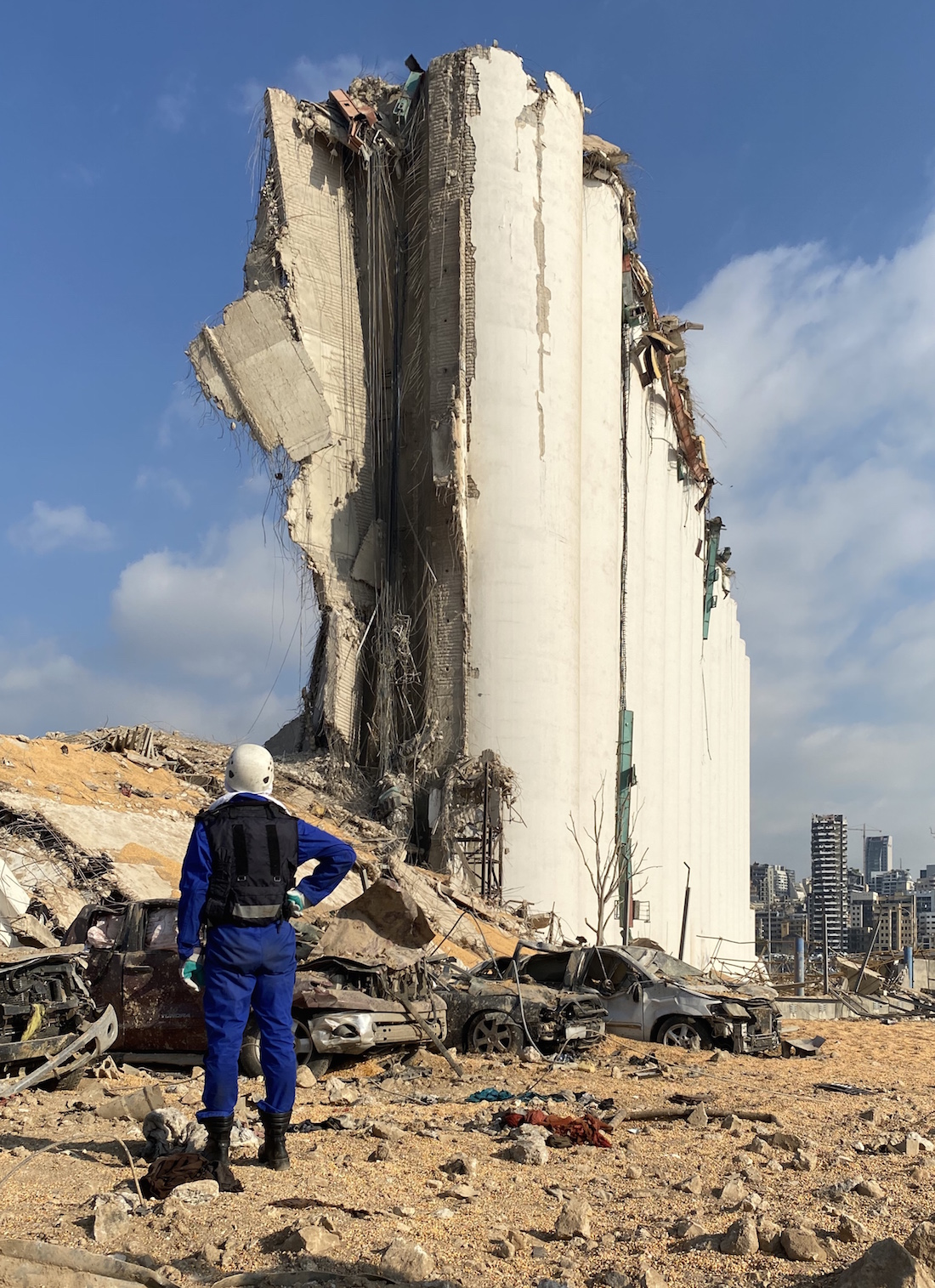 A rescue worker stands by the Beirut Port grain silo during a search operation. Beirut, Lebanon. August 6, 2020. (Zein Jaafar/The Public Source)