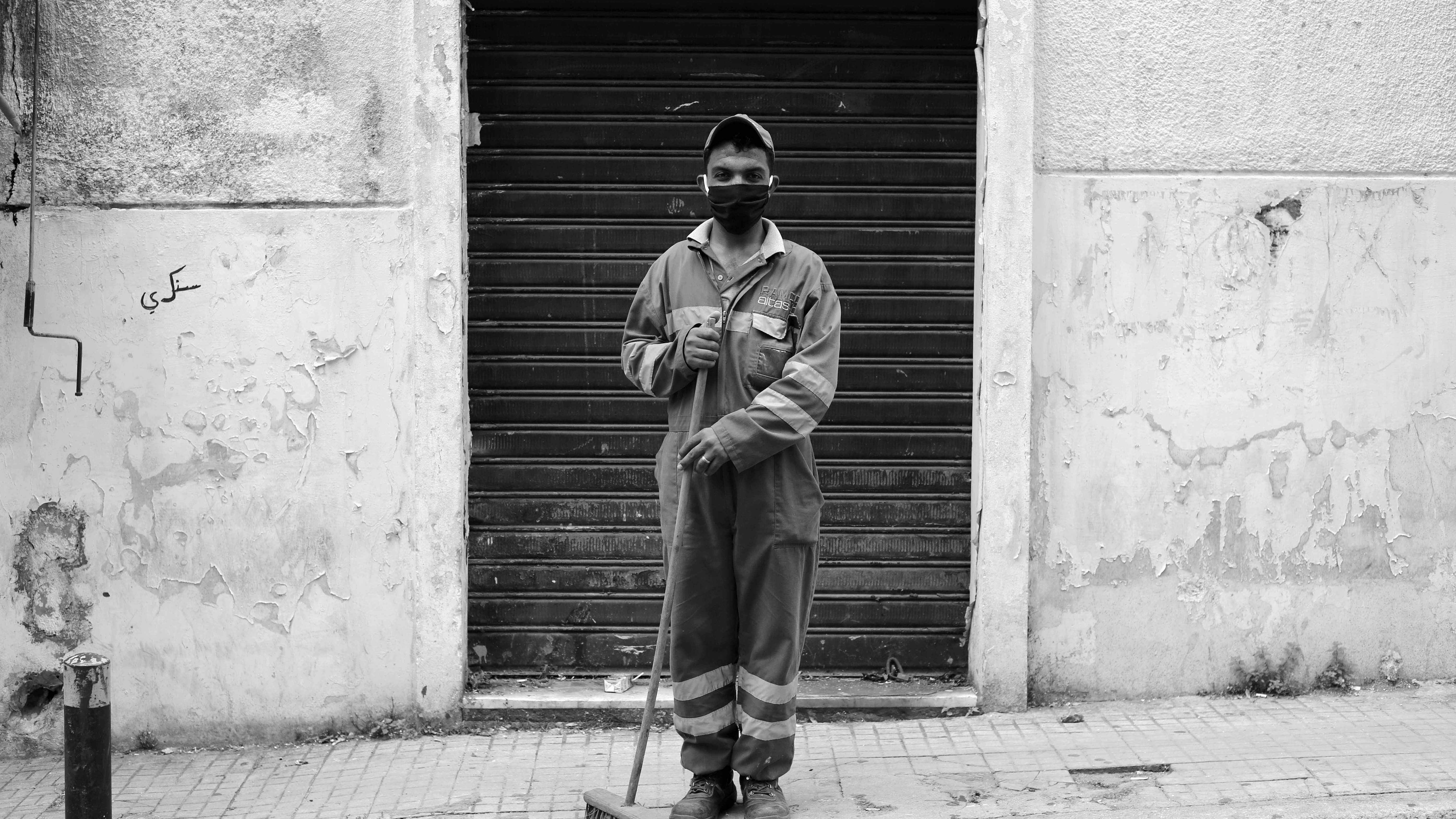 A sanitation worker employed by Lebanese company Ramco pauses for a picture while working a shift at the peak of the COVID-19 pandemic. April 6, 2020. (Marwan Tahtah/The Public Source)