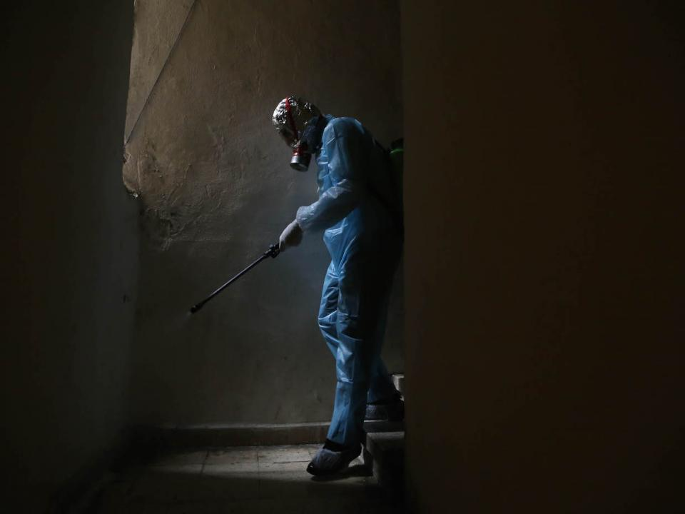 A volunteer health worker disinfects a building in Ras Beirut. Beirut, Lebanon. March 20, 2020. (Hussein Baydoun/The Public Source)