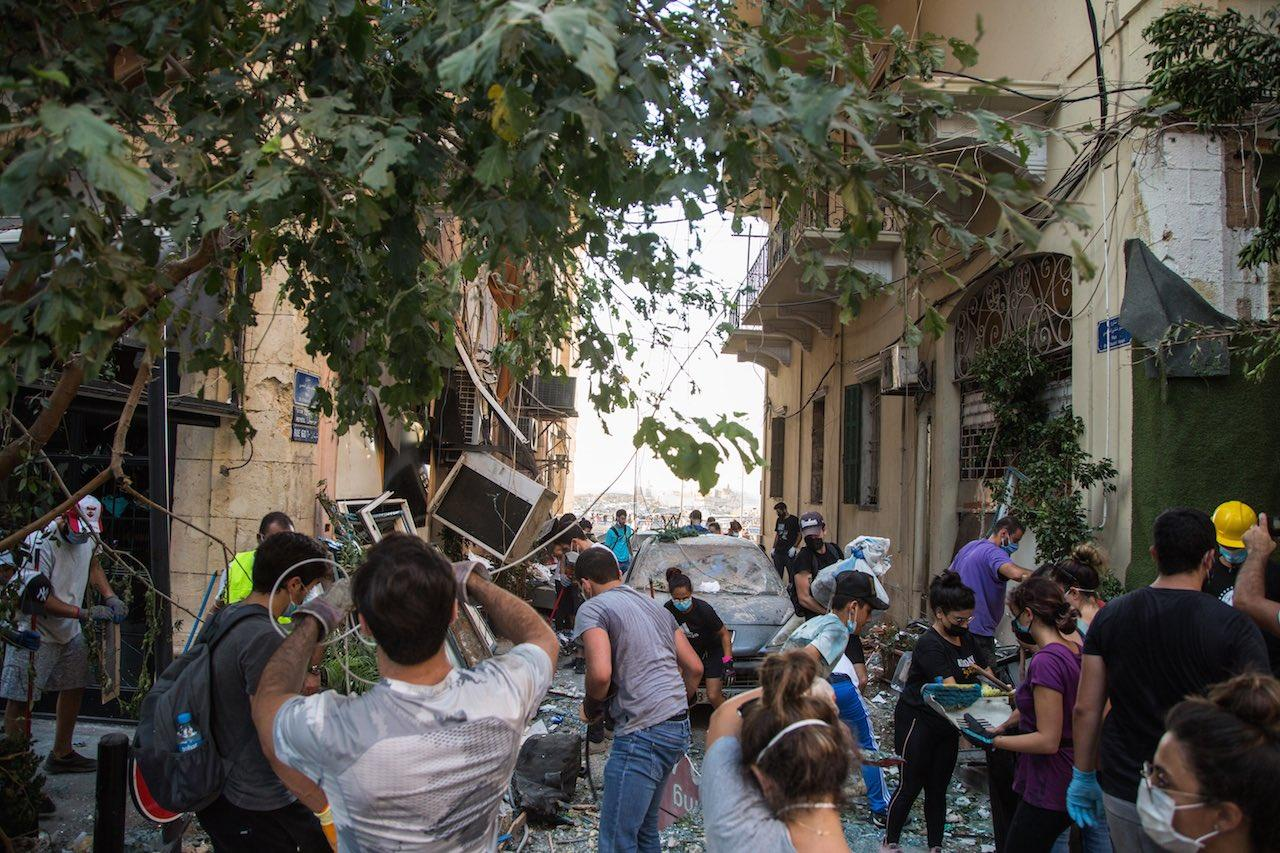 Volunteers and residents cleanup destroyed Mar Mikhael near the Beirut Port.