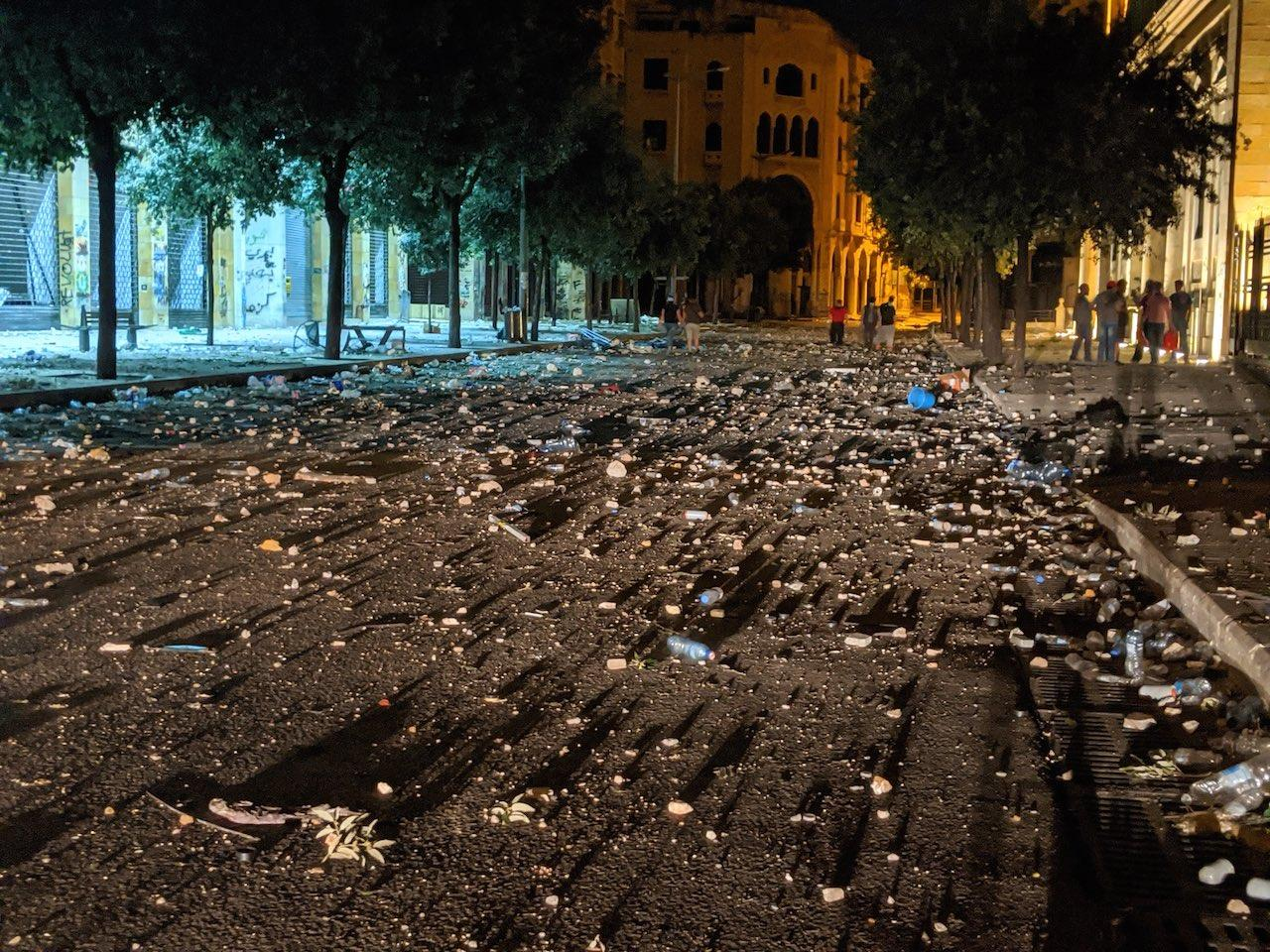 Downtown Beirut littered with tear gas canisters, rubber bullets, and debris following clashes.