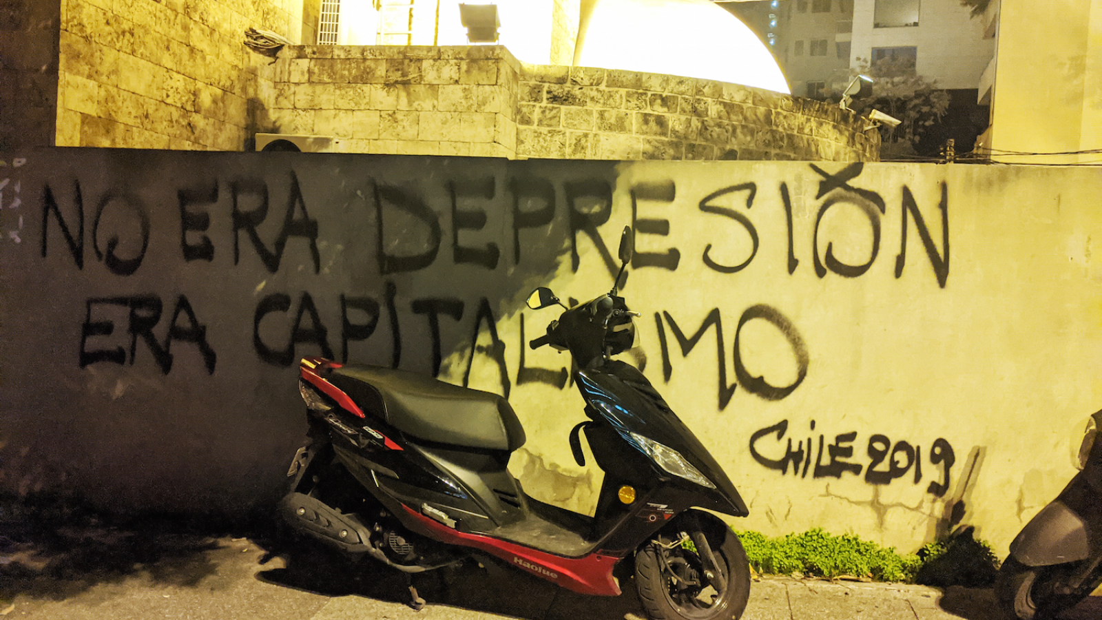 "Inspired by a banner carried by protesters Chile, ""it's not depression, it's capitalism"" reads this wall in Beirut, Lebanon. December 4, 2019. (Lara Bitar/The Public Source)"