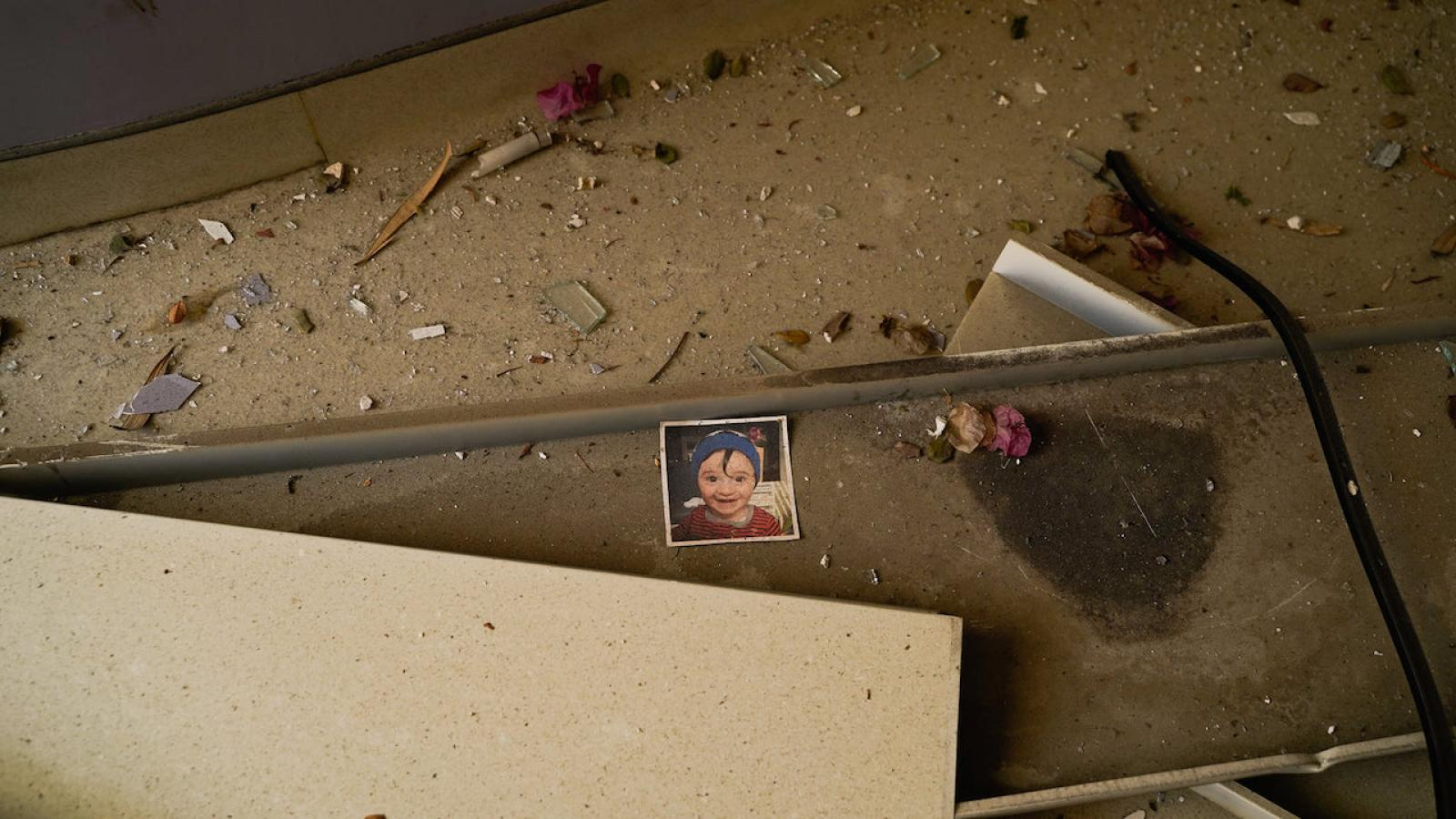 A photo of a child is left in the rubble of Beirut's destroyed St.Georges Hospital.